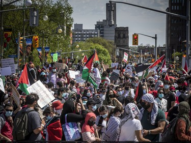Crowds police estimated at 3,000 marched in downtown Ottawa on Saturday to protest the continuing violence in East Jerusalem.