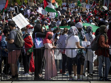 Thousands marched in downtown Ottawa on Saturday to protest the continuing violence in East Jerusalem.
