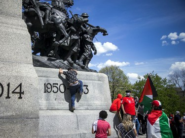 Crowds police estimated at 3,000 marched in downtown Ottawa Saturday to protest the continuing violence in East Jerusalem Saturday, May 15, 2021. Protestors unsuccessfully tried to gain access to the top of the War Memorial Saturday.