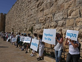 Members of Women Wage Peace, an Israeli grassroots peace movement, take part in a rally calling for coexistence and an end to the Israeli-Palestinian conflict, along Jerusalem's Old City walls, on May 19.