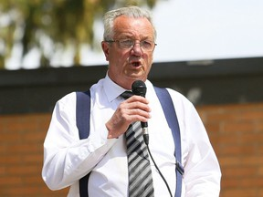 Independent MPP Randy Hillier speaks at an anti-lockdown protest at Tecumseh Park in Chatham, Ont., on Monday, one day after a similar event at a church in Aylmer, Ont., led to charges against six people, including Hillier.
