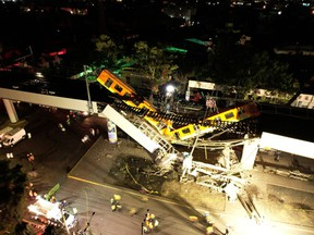 A general view of damage caused after a railway overpass and train collapsed onto a busy road in this drone picture obtained from social media Mexico City, Mexico May 4, 2021.