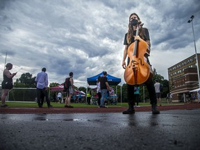Raph Weinroth-Browne, a cello player with Ottawa Chamberfest was one of a few musicians on site to entertain the Jabapalooza crowd Saturday. The weather caused a slight pause in the performances but workarounds were quickly organized at Dr. Nili Kaplan-Myrth's third Jabapalooza held on the field at Immaculata High School, Saturday,