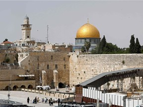 A picture taken on May 21, 2021, shows Jerusalem's Western Wall (R), the holiest site where Jews can pray, and the Dome of the Rock (C) mosque inside Islam's third holiest shrine, the Al-Aqsa mosque compound.