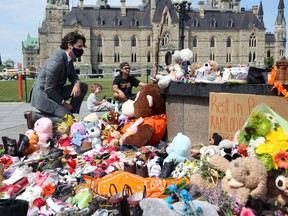 In this photo taken on June 1, Prime Minister Justin Trudeau visits the makeshift memorial erected on Parliament Hill in honour of the 215 Indigenous children whose remains were found at a residential school in British Columbia.