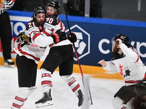 Canada's forward Nick Paul (C) celebrates scoring the winning 3-2 goal with team mate Canada's defender Troy Stecher (C) during the IIHF Men's Ice Hockey World Championships final match between the Finland and Canada at the Arena Riga in Riga, Latvia, on June 5, 2021.