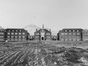 A historical photo of the Kamloops Indian Residential School, once the largest facility in the Canadian Indian Residential School system. Recent radar surveys have found evidence of 215 unmarked graves.