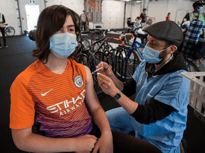 """""""There was overwhelming enthusiasm"""" at Montreal pop-up and walk-in COVID vaccination clinics, like this one, when teens became eligible."""