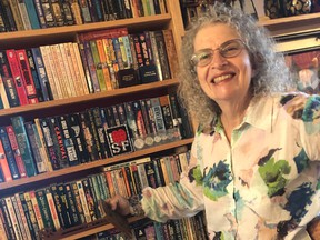 1.Victoria Sutherland estimates she has more than 200 feet of bookshelves covering two walls.