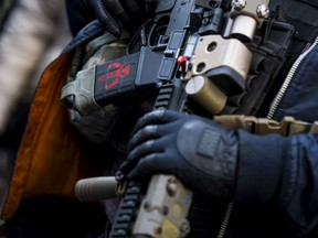 FILE: A demonstrator holds a gun during a rally organized by The Virginia Citizens Defense League on Capitol Square near the state capitol building on January 20, 2020 in Richmond, Virginia.