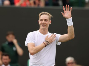 Denis Shapovalov of Canada celebrates victory after winning his Men's Singles Fourth Round match against Roberto Bautista Agut of Spain during Day Seven of The Championships at Wimbledon.