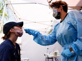 A medical assistant administers a COVID-19 test.