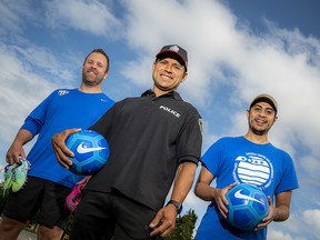 From left: Craig Stead, director of soccer operations and community engagement with Ottawa South United Soccer; Ottawa Police Services acting staff sergeant Fernando Vieira; and Zaid Al-Shorafat, employment counsellor, sport and recreation lead with the Catholic Centre for Immigrants. The trio has come together to help distribute soccer balls and cleats to youth in underprivileged neighbourhoods.