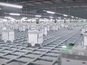 An Ocado 'hive' scuttle around the grid in a video by the company.