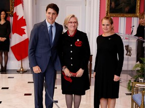 Carolyn Bennett poses with Prime Minister Justin Trudeau and then-governor general Julie Payette after being presented as Minister of Crown-Indigenous Relations on Nov. 20, 2019. Payette is gone, and Bennett is in hot water.
