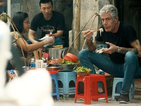 """This image released by Focus Features shows Anthony Bourdain in Morgan Neville's documentary """"Roadrunner."""" MUST CREDIT: Focus Features"""