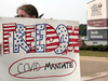 A protest against mandatory COVID-19 vaccinations for healthcare workers in front of a hospital in Livonia, Michigan, on July 24, 2021.