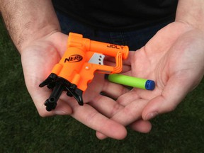 A mini Nerf gun got two teenagers arrested after they shot darts out of their car in a TikTok- inspired prank. Now, the SIU is investigating.