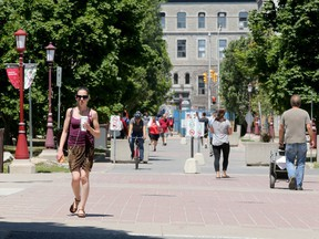 File photo/ Some students and faculty mill around campus at University of Ottawa.