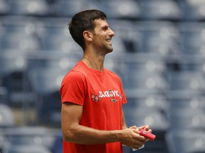 Novak Djokovic of Serbia smiles during a practice session prior to the start of the 2021 US Open at USTA Billie Jean King National Tennis Center on August 28, 2021.