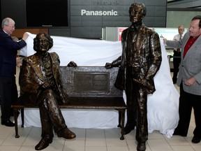A file photo of the bench with statues of Sir John A. Macdonald and Sir Georges-Etienne Cartier at the Ottawa International Airport.