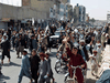 Taliban supporters celebrate in Kandahar after the U.S. pulled out the last of its troops from Afghanistan, August 31, 2021.