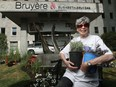 Kathleen Walker takes a break from gardening in front of the Élisabeth Bruyère Hospital in Lowertown on Monday. In late stages of terminal cancer, Walker and partner are redoing the front garden at the hospital, where she has spent time in palliative care.
