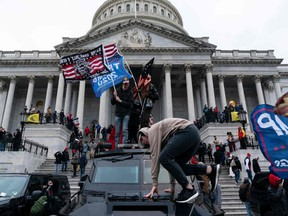 Donald Trump's supporters protest outside the U.S. Capitol in Washington on Jan. 6.
