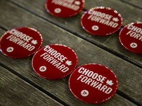 Buttons sit on the table at Mona Fortier, the Liberal candidate for the Ottawa-Vanier riding, gathering at Tavern on The Hill in Major's Hill Park on Sept. 20, 2021.