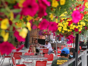 Patrons enjoy a patio in the ByWard Market in Ottawa. To survive, restaurants may have to operate very differently in future.