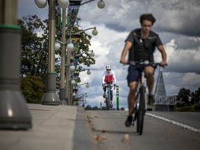 Cyclists make their way down Sussex Drive in Ottawa. Making downtown (and other) streets safe for cyclists and pedestrians is key to creating '15-minute' neighbourhoods.