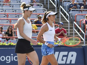 Gabriela Dabrowski of Canada (L) and Luisa Stefani of Brazil (R) play during their Womens Doubles Final match against Darija Jurak of Croatia and teammate Andreja Klepac of Slovenia on Day Seven of the National Bank Open presented by Rogers at IGA Stadium on August 15, 2021 in Montreal.