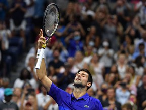 Serbia's Novak Djokovic celebrates his win over USA's Jenson Brooksby during their 2021 US Open Tennis tournament men's singles fourth round match at the USTA Billie Jean King National Tennis Center in New York, on September 6, 2021.