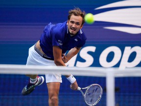 Russia's Daniil Medvedev hits a return to Canada's Felix Auger-Aliassime during their 2021 US Open Tennis tournament men's semifinal match at the USTA Billie Jean King National Tennis Center in New York, on September 10, 2021.