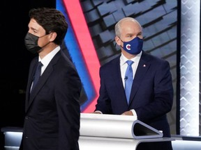FILE: Liberal leader Justin Trudeau and Conservative Party leader Erin O'Toole leave the room following the federal election French-language leaders debate, in Gatineau, Quebec, Canada September 8, 2021.