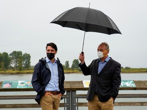 Justin Trudeau and climate scientist Andrew Weaver during an election campaign stop in Richmond, British Columbia, Sept. 14, 2021.