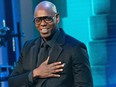 """Comedian Dave Chappelle, shown at the Kennedy Center in Washington, DC. on October 27, 2019, has thumbed his nose at critics who accuse him of transphobia, telling a packed Los Angeles performance: """"If this is what being canceled is like, I love it."""""""
