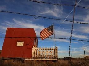 """The entrance to the film set of """"Rust"""" is seen through a barbed wire fence after Hollywood actor Alec Baldwin fatally shot a cinematographer and wounded a director when he discharged a prop gun on the movie set in Santa Fe, New Mexico, U.S., October 22, 2021."""