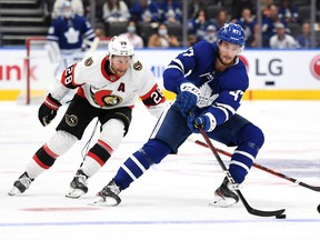 Toronto Maple Leafs forward Pierre Engvall (47) carries the puck past Ottawa Senators forward Connor Brown (28) in the second period at Scotiabank Arena Saturday night.