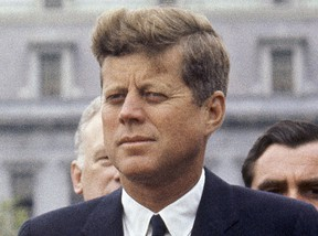 In this April 30, 1963 file photo, President John F. Kennedy listens while Grand Duchess Charlotte of Luxembourg speaks outside the White House in Washington.