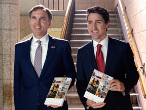Finance Minister Bill Morneau and Prime Minister Justin Trudeau proudly display copies of the federal budget on March 22, 2017.