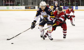 Ottawa 67's defenceman Noel Hoefenmayer tries to get the puck from a member of the Barrie Colts. (ASHLEY FRASER/Postmedia Network)