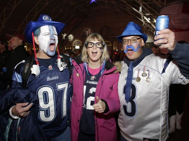 Appearances suggest the Argos have the support of these fans, left to right, Mark Bottaro, Debbie Geldart and Mark Geldart. David Kawai/Postmedia