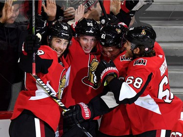 The Senators' Mat Duchene, second from left, celebrates his first goal with his new team with Derick Brassard (19), Mark Stone (61) and Mike Hoffman (68) during the third period. THE CANADIAN PRESS/Justin Tang