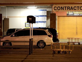 A vehicle is surrounded by a police perimeter in the parking lot of a Home Depot store, Tuesday, Oct. 31, 2017, in Passaic, N.J. Police investigating a rented Home Depot truck's deadly rampage down a bike path near New York's World Trade Center have surrounded the white Toyota minivan with Florida plates parked in the lot. (AP Photo/Julio Cortez)