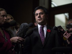 Ontario Attorney General Yasir Naqvi scrums with the media in the Queens Park Legislature in Toronto on Nov. 1. He, and corrections minister Marie-France Lalonde, have some explaining to do, write two academics.