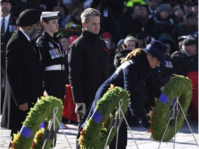 Sophie Gregoire Trudeau, Harjit Sajjan, Seamus O'Regan  Sophie Gregoire Trudeau, wife of Prime Minister Justin Trudeau, right, lays a wreath as Minister of National Defence Harjit Sajjan, left, and Minister of Veterans Affairs and Associate Minister of National Defence Seamus O'Regan look on during the National Remembrance Day Ceremony at the National War Memorial in Ottawa on Saturday, Nov. 11, 2017. THE CANADIAN PRESS/Justin Tang ORG XMIT: JDT110 Justin Tang,