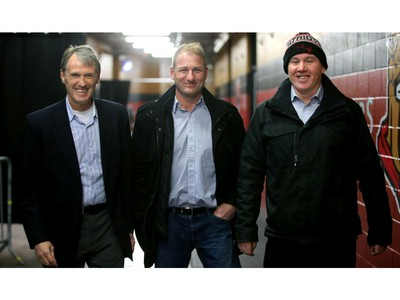 From left, Laurie Boschman, Brad Smythe and Shaun Van Allen arrive at the rink.