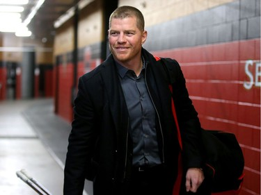 Newly retired Chris Neil arrives all smiles.