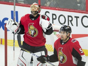 Ottawa Senators goalie Craig Anderson and defenceman Cody Ceci react at the final whistle of a 3-2 win over the Rangers. Both players had strong games.